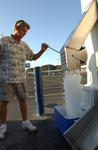 An Ice House America customer fills up his cooler with 20lbs of ice in 8 seconds.