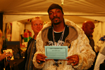 Snoop Dogg with OPB certificate. Copyright Open Book Press 2006