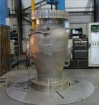 Weld cladding a large valve
