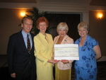 Caption: On behalf of their Top Producing Agents for 2005, John R. Wood, Inc. Realtors President and CEO Phil Wood and company COO Dottie Babcock present a check for $10,000 to NABOR's Community Involvement Co-Chairs Carol Kirchdorfer and Carol Yates. The check was presented during the Wood firm's Annual Awards Breakfast held at the Naples Beach Hotel & Golf Club on Thursday, March 2, 2006 and will be used by NABOR to help build Habitat for Humanity homes in the Trail Ridge community of Naples.