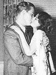 Nelson Eddy kisses Jeanette MacDonald in a candid 1938 shot that infuriated their MGM boss, Louis B. Mayer.