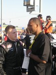 NASCAR owner Julius Curry and driver Chase Montgomery discuss strategy before the qualifier at the John Deere 200 in Atlanta.