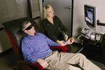 Laser therapist treating a client for his nicotine addiction.