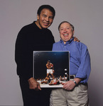 Muhammad Ali and Neil Leifer holding Leifer's famous photograph of Ali knocking out Sonny Liston in 1965, 40 years later in Washington, D.C., March, 2005