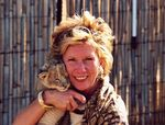Patsy Smith Roberts with a rescued lion cub.