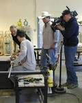 """Preston Sharp from """"Extreme Makeover: Home Edition"""" supervising work being made by Jon Goldberg and Owen Pach."""