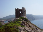 A watch tower on the enchanted Sardinian coast .