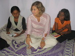 Literacy volunteer with students in India