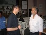 President Xanana Gusmao Confers with Consensus' Zachary Metz at East Timor's NGO Summit