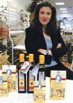 Esther Luongo Psarakis, owner of Taste of Crete with some of her products