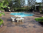 Decorative concrete is a great choice for pool deck materials.