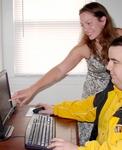 Geek Housecalls customer 10,000, Erica Flynn with her personal geek, Charlie Hoover.