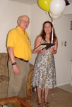 Geek Housecalls customer number 10,000, Erica Flynn accepts awards for free year of computer service and Boston Harbor cruise for 10 from Geek Housecalls President, Dave Ehlke