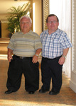 "The World's Smallest Evangelist, Bobby Brindle (left) meets Evangelist James ""The Giant"" Croft during the 2005 LPA Convention in Florida."