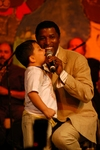 Kenny 'Babyface' Edmonds performs with a Help Group student at The Help Group's 29th Annual Teddy Bear Picnic in Beverly Hills, CA on June, 8, 2006.