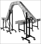 """Truly Modular"" lightweight conveyor system featuring ascending/descending components."