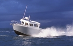 Neah Bay, WA: The boat is traveling at 43 knots as it passes by the photo boat.