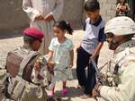 3rd Battalion Iraqi Army Lieutenant greeting Iraqi children along with Captain James Van Thach