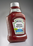 The iconic bottle echoes classic brand equities, such as octagonal facets and neckband, while the classic Heinz keystone appears in the bottle's silhouette and snap back closure