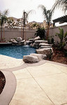 Concrete pool decks come in all shapes and colors