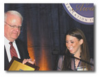 Cassidy Goldstein accepts her 'Inventor of the Year' award from Congressman Sensenbrenner