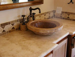 Above-the-counter vessel sink.