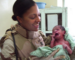 STOCK:  Army physician after delivering baby