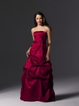 Satin strapless ball gown with pick-up detailing on skirt and sash at waist.