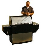 Traeger grill inventor Joe Traeger shows off the recently re-designed Deluxe model.