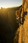 """Katie Brown ascending the """"Tombstone Crack"""" at Smith Rock, Oregon."""