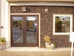 Simulated stone siding adds to a storefront's appeal