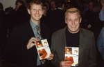 Steve Cram and George at the original launch party of In the Long Run. This was held at Saatchi & Saatchi's London office on Tuesday 14th March 2000, and was hosted by Alan Bishop, the then International Chairman of the company.