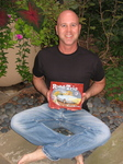 David J. Billings holds a copy of his self-published children's book.