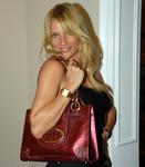 Nicollette Sheridan with Charlie Lapson Handbag