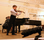 Dmitrij Smirnov is shown on the stage of St. Petersburg's Philharmonic Hall during his award winning performance at the Crescendo Festival in April 2006