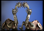 Pair of E. Garcia California-style Spurs with silver inlaid revolvers for heel bands and shanks.
