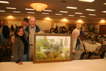 High bidders Karl and Lorraine with Lisa Loucks Christenson (left) pose for shot with Lisa Loucks Christenson's first annual collector print for Rochester Area Chapter Ducks Unlimited (Photo: Dave Christenson)
