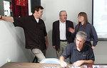 Bruce, Ron and Darlene behind Chris Howe