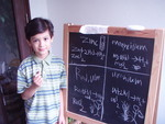 Ainan Celeste Cawley, 6, writes chemical equations