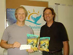Chris Pesenti of ProPeninsula accepts donation from Ric Kraszewski of Whale Tails Tortilla Chips