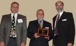 WellDog CEO Wayne Greenberg (far right) accepts FLC Award