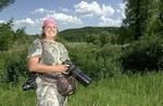 Lisa Loucks Christenson began shooting in the Whitewater Wildlife Management Area in April 2005 and has been there daily ever since-- no matter what.  Photo: John Weiss/ Post-Bulletin
