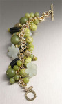 Jade bracelet with hand-carved Onyx, Olive Serpentine, and Yellow Turquoise