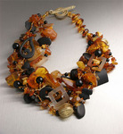 Amber necklace with hand-carved Onyx, Citrine, and Carnelian