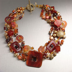 Hand-carved Carnelian necklace with Freshwater Pearls, Swarovski Crystals, and Amber