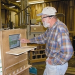 Alaskan Wood Moulding's Master Craftsman Bohush Fiala hates computers, but he loves TaskKlock's ATM-simple touchscreen interface.