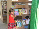 Youth of Indian Church Village in northern Belize enjoy their library in part supported by Beyond Touring Inc.