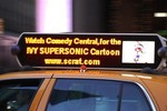 Supersonic advertises her website scrat.com and campaigns on top of taxi cabs in New York.