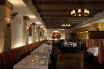 Faux bamboo and wood beams add warmth to a restaurant