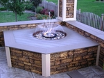 An outdoor fountain dressed up with simulated stone siding